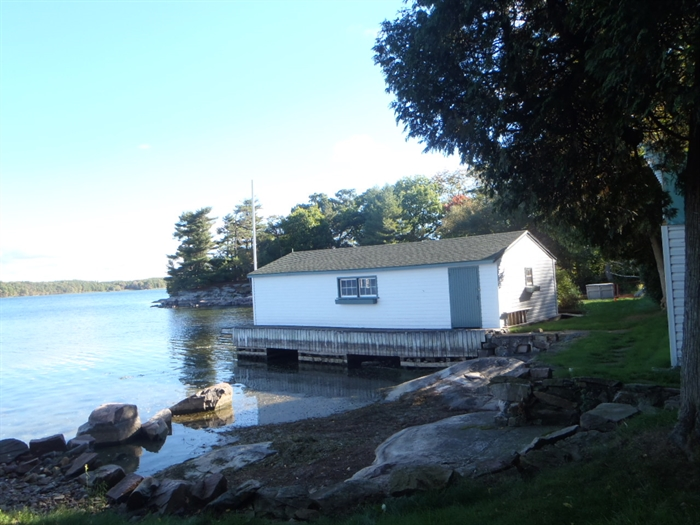 Low water allows us to see how a boathouse is supported.