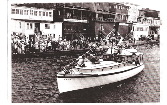 FLOX (shown with flybridge) passing in review for the 1972 Antique Boat Show, Clayton NY