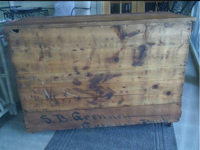 A crate addressed to the S. B. Grenell, found in the Dawes Cottage recently.