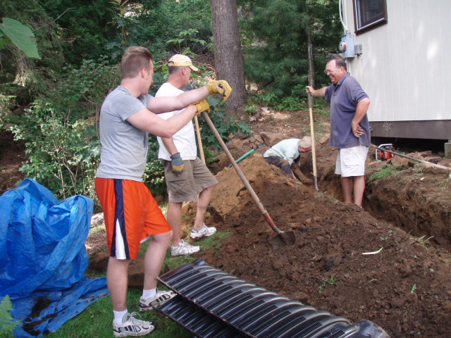 Neighbors help the Richards install a new leech field in 2009