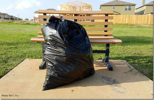Green Garbage Bag in sun
